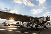 December 16, 2016<br /> Volunteers at Pine Mountain Lake Airport in Groveland, California, push a 1928 Ford Tri-Motor airplane toward a fuel pump, in the late afternoon on Friday, December 16, 2016.<br /> <br /> This Ford Tri-Motor NC9645, nicknamed The Tin Goose, has a wingspan of 77 feet 6 inches and was constructed in 1928. It was named the City of Wichita, and it was used to introduce the first coast-to-coast passenger air/rail service in the United States on July 7, 1929, and the development and inauguration of the first all air passenger service on October 25, 1930.<br /> <br /> Experimental Aircraft Association (EAA) is a worldwide organization of aviation enthusiasts. EAA&rsquo;s 185,000 members and 1,000 local chapters enjoy sharing their passion for flying, building and restoring aircraft. Pine Mountain Lake&rsquo;s EAA Chapter 1337 is hosting the airline&rsquo;s visit.