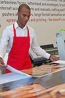 Industrial manual worker working in printing press