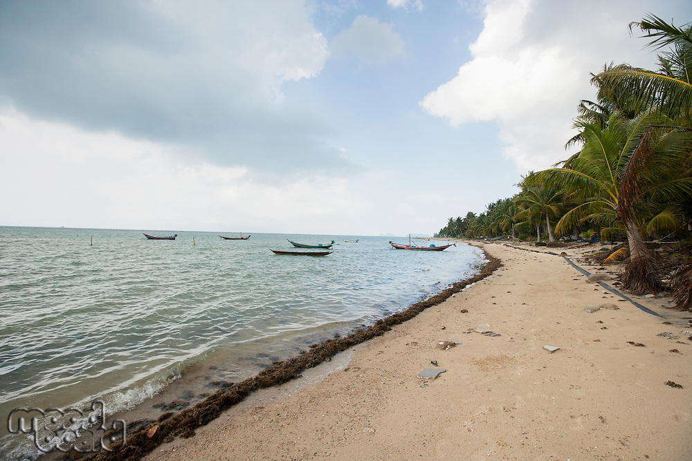 Fishing boats on shore; Koh Pha Ngan; Thailand
