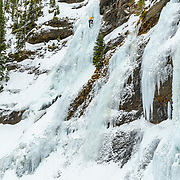 Matt Ward leading a route called Twin Falls WI3 in Hyalite Canyon Montana
