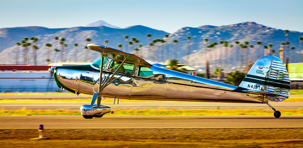 A Cessna 170 taxis by at Gillespie Field,  El Cajon, California.