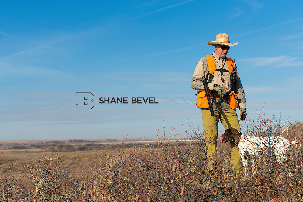 12/8/12 11:31:04 AM -- Quail hunting on the Cimarron Hills WMA in western Oklahoma. <br /> <br /> Photo by Shane Bevel