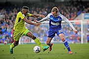 Ipswich Town forward Freddie Sears (20) takes on Rotherham United midfielder Darnell Fisher (17) during the EFL Sky Bet Championship match between Ipswich Town and Rotherham United at Portman Road, Ipswich, England on 29 October 2016. Photo by Nigel Cole.