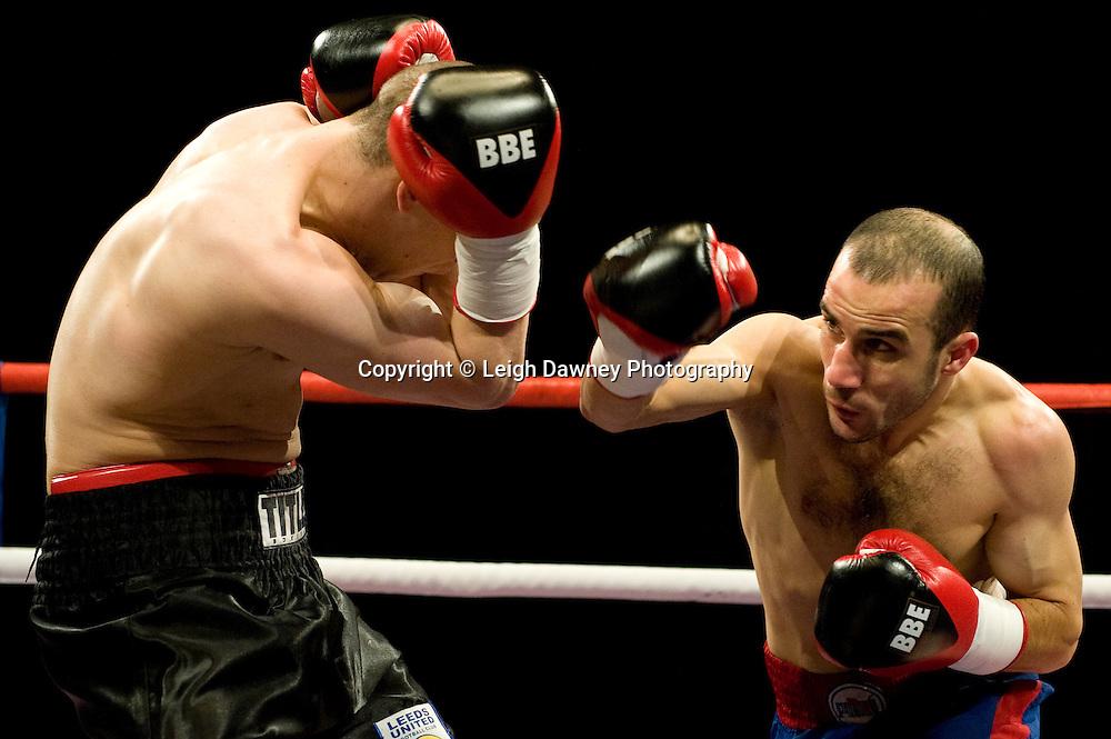 Carl Johanneson (black shorts) defeats Youseff Al Hamidi at the Harvey Hadden Leisure Centre 5th February 2010 Frank Maloney Promotions . Photo credit © Leigh Dawney