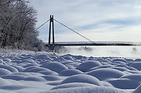Winter landscape photography on the shore of the Bow River with the Southland Pedestrian Bridge in the background. It was an extremely cold day and a beautiful layer of ice fog blanketed the river.<br /> <br /> &copy;2017, Sean Phillips<br /> http://www.RiverwoodPhotography.com
