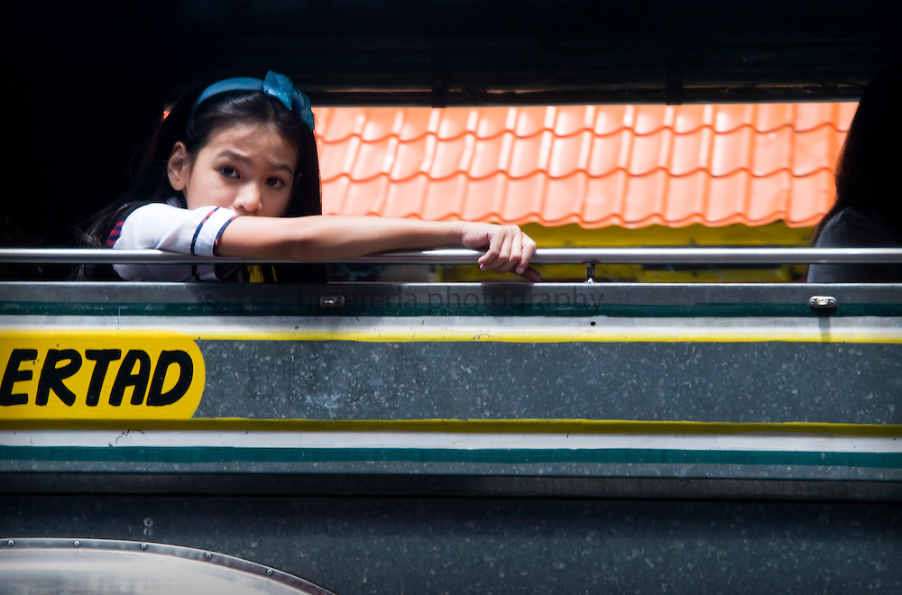 MANILA (Philippines). 2009. A girl in a jeepney in the streets of Manila.