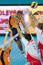 01-07-2012 VOLLEYBAL: EUROPEAN LEAGUE TURKIJE - NEDERLAND: ANKARA<br /> Nederland wint de European League 2012 door Turkije met 3-2 te verslaan / <br /> Tony Krolis (#6 NED) - Ahmet Pezuek (#3 TUR), Ulas Kiyak (#1 TUR)<br /> ©2012-FotoHoogendoorn.nl/Conny Kurth