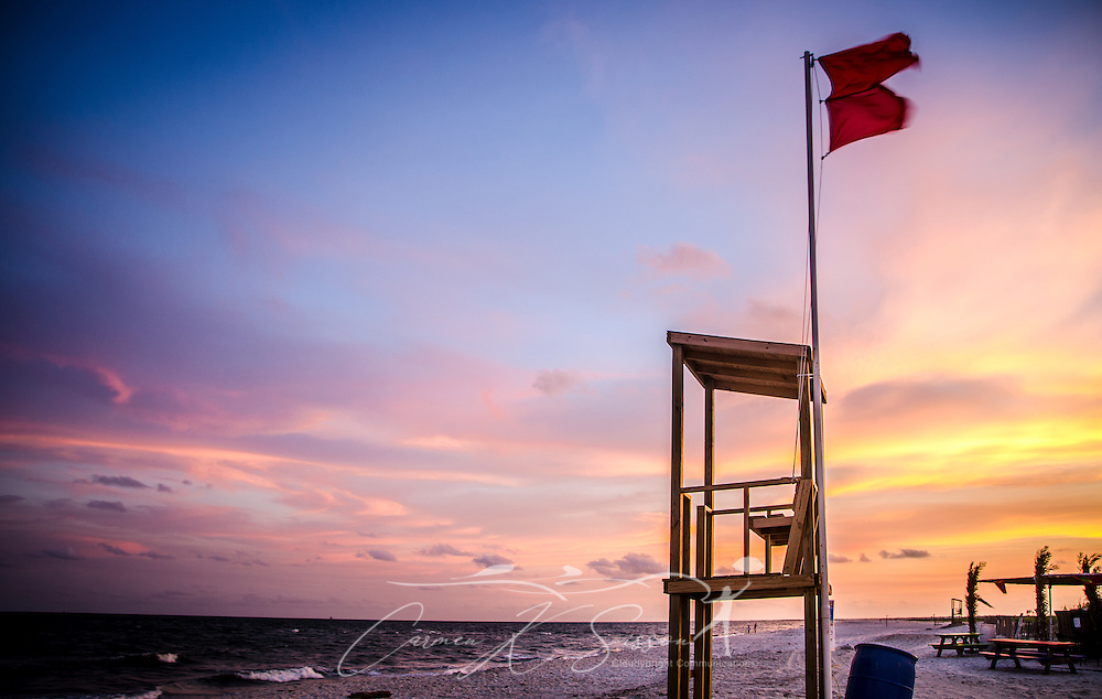 Double flags warn swimmers of the potential for rip currents as a storm approaches Dauphin Island's west end in Alabama. (Photo by Carmen K. Sisson/Cloudybright)