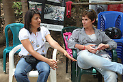 Local leader Yolanda Oqueli (left) speaks with renowned Guatemalan Ecologist Magali Rey Rosa at the La Puya resistance blockade. Yoli Oqueli suffered a murder attempt on June 13, 2012, due to her involvement with the anti-mining movement. The bullet is still lodged in her back. Since March 2nd, 2012, local neighbors from San José del Golfo and San Pedro Ayampuc have blocked the entrance to the EXMINGUA gold mine - owned by Kappes, Cassiday & Assocaites (KCA) based in Reno, Nevada, USA. Residents from the communities claim the industrial activity in their territories as illegal since they were not appropriately consulted before the mine began operating. La Puya, San Pedro Ayampuc, Guatemala. May 14, 2013.