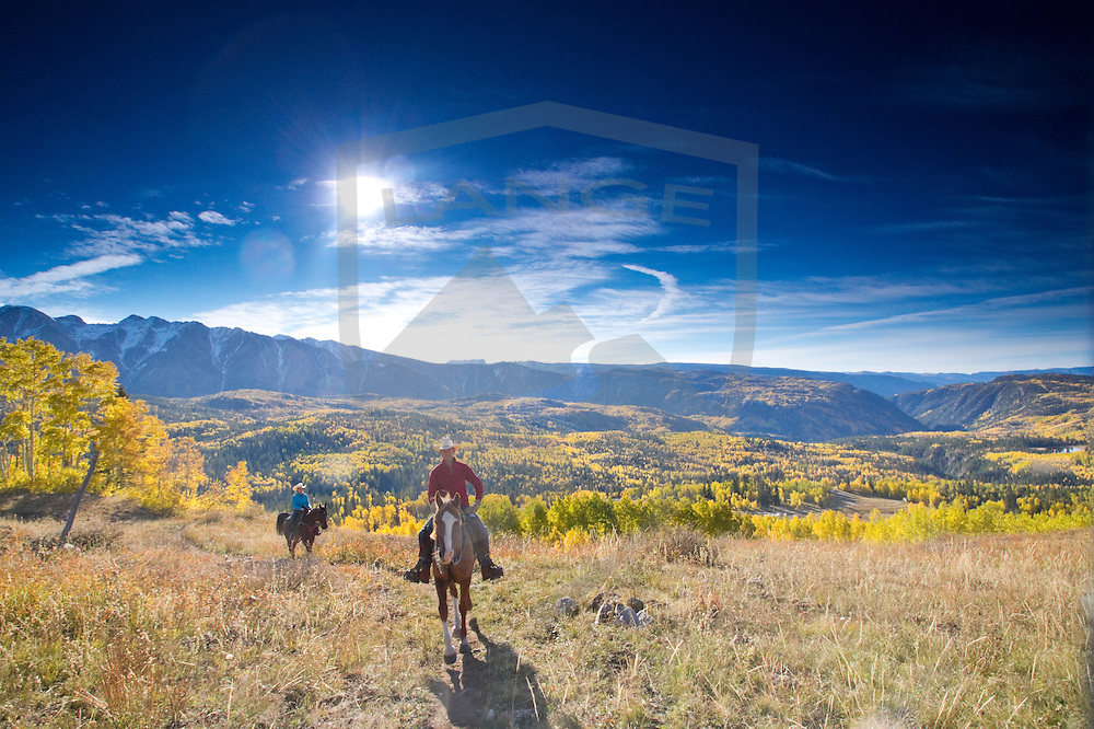 horseback riding the autumn mountain landscape.  engineer mountain, san juan range, colorado rocky mountains of durango.