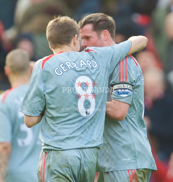 MANCHESTER, ENGLAND - Saturday, March 14, 2009: Liverpool's captain Steven Gerrard MBE and Jamie Carragher celebrate their side's 4-1 demolition of Manchester United during the Premiership match at Old Trafford. (Photo by David Rawcliffe/Propaganda)