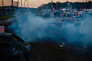 A competitor in the demolition derby blows a head gasket at Summitt County Fairgrounds, Thursday, July 26, 2016 in Tallmadge, Ohio. All cars participating had previously been used in at least one demoltion derby.