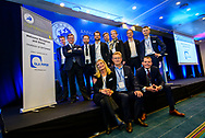 Team members from DLA Piper pose for a group photo on stage during the INSOL Europe Annual Congress at Scandic Copenhagen Hotel in Copenhagen.