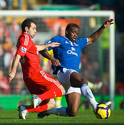 LIVERPOOL, ENGLAND - Saturday, February 6, 2010: Liverpool's Javier Mascherano and Everton's Louis Saha during the Premiership match at Anfield. The 213th Merseyside Derby. (Photo by: David Rawcliffe/Propaganda)