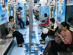 July 5, 2018 - Hangzhou, Hangzhou, China - Hangzhou, CHINA-Passengers at a summer themed subway train in Hangzhou, east China's Zhejiang Province. (Credit Image: © SIPA Asia via ZUMA Wire)