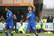 AFC Wimbledon striker Lyle Taylor (33) celebrating after scoring goal to make it 2-1during the The FA Cup match between AFC Wimbledon and Charlton Athletic at the Cherry Red Records Stadium, Kingston, England on 3 December 2017. Photo by Matthew Redman.