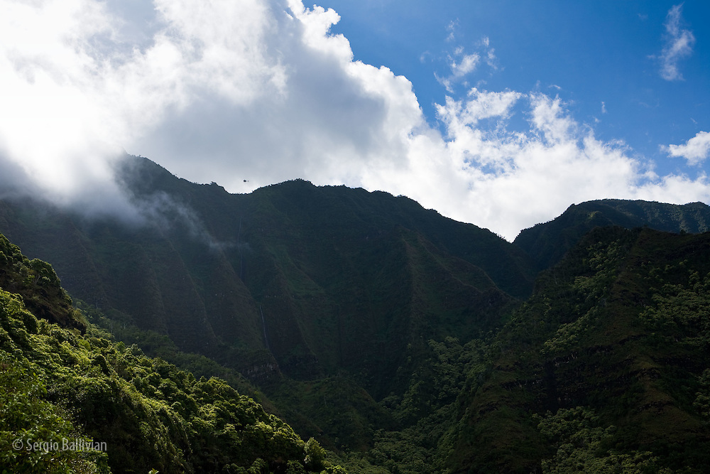 The rugged fluted ridges and  lush landscape of the Kalalau Trail on the Na Pali coast of the north shore of Kauai, Hawaii.