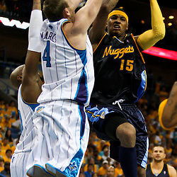 25 April 2009: Denver Nuggets forward Carmelo Anthony (15) challenges New Orleans Hornets defenders Sean Marks (4) and David West (30) during a 95-93 win by the New Orleans Hornets over the Denver Nuggets in game three of the NBA Western Conference quarter-finals playoff at the New Orleans Arena in New Orleans, Louisiana.