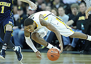 January 14, 2011: Iowa Hawkeyes guard/forward Roy Devyn Marble (4) tries to keep control of the ball during the NCAA basketball game between the Michigan Wolverines and the Iowa Hawkeyes at Carver-Hawkeye Arena in Iowa City, Iowa on Saturday, January 14, 2011. Iowa defeated Michigan 75-59.