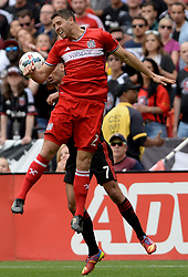 May 20, 2017 - Washington, DC, USA - 20170520 - Chicago Fire midfielder MATT POLSTER (2) and D.C. United midfielder MARCELO SARVAS (7) battle for a head ball in the second half at RFK Stadium in Washington. (Credit Image: © Chuck Myers via ZUMA Wire)