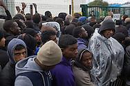 Calais, Pas-de-Calais, France - 22.10.2016    <br />  <br /> Refugees and migrants line up for a minors registration. So called &rdquo;Jungle&quot; refugee camp on the outskirts of the French city of Calais on the weekend before the scheduled eviction. Many thousands of migrants and refugees are waiting in some cases for years in the port city in the hope of being able to cross the English Channel to Britain. French authorities announced that they will shortly evict the camp where currently up to up to 10,000 people live.<br /> <br /> Fluechtlinge und Migranten stehen in der Schlage wegen einer Registrierung von Minderjaehrigen. Das sogenannte &rdquo;Jungle&rdquo; Fluechtlingscamp am Rande der franzoesischen Stadt Calais, am Wochenende vor der angesetzten Raeumung. Viele tausend Migranten und Fluechtlinge harren teilweise seit Jahren in der Hafenstadt aus in der Hoffnung den Aermelkanal nach Gro&szlig;britannien ueberqueren zu koennen. Die franzoesischen Behoerden kuendigten an, dass sie das Camp, indem derzeit bis zu bis zu 10.000 Menschen leben K&uuml;rze raeumen werden. <br /> <br /> Photo: Bjoern Kietzmann