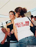 Girl wearing a 'Fuck me i'm famous' T shirt Ibiza 2001