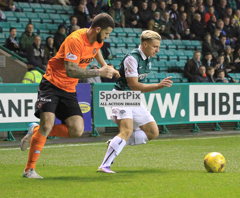 Hibernian V Dundee United Scottish League Cup Quarter Final 4th November 2015; Hibernian's Jason Cummings and Dundee United's Mark Durnan during the Hibernian V Dundee United League Cup Quarter Final tie, played at Easter Road Stadium, Edinburgh.