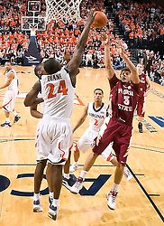 Virginia guard/forward Mamadi Diane (24) blocks a shot by Florida State guard Luke Loucks (3).  The Virginia Cavaliers fell to the Florida State Seminoles 73-62 in NCAA Basketball at the John Paul Jones Arena on the Grounds of the University of Virginia in Charlottesville, VA on January 24, 2009.