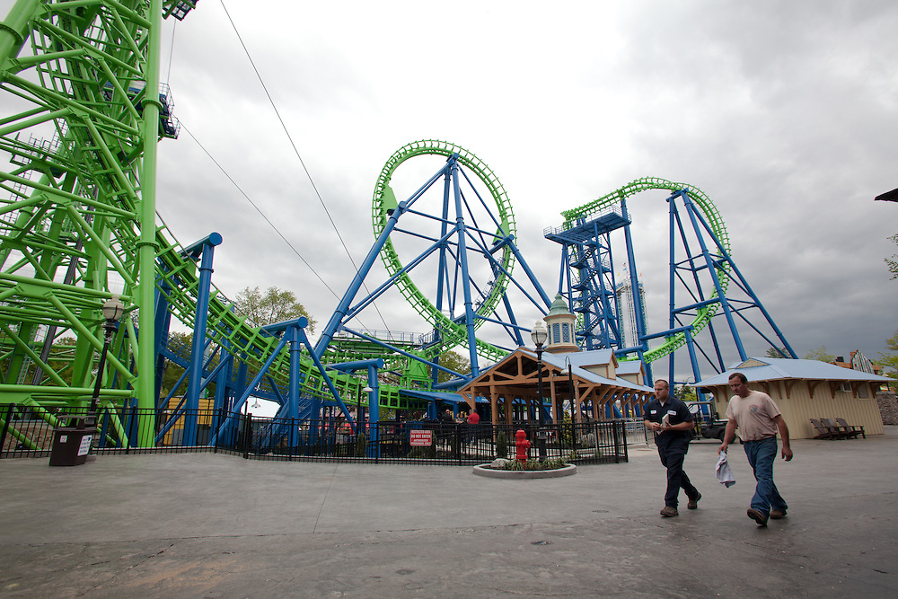 "Workers walk past the new ""Goliath"" roller coaster at Six Flags New England in Agawam Mass., on Thursday May 10, 2012.  (Photo by Matthew Cavanaugh)"