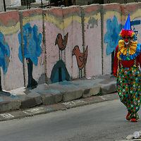 are seen during a parade to celebrate the Jewish holiday of Purim on March 10, 2009 in Hebron. The carnival-like Purim holiday is celebrated from tonight with parades and costume parties. It commemorates the deliverance of the Jewish people from a plot to exterminate them in the ancient Persian empire 2,500 years ago. Photo by Olivier Fitoussi