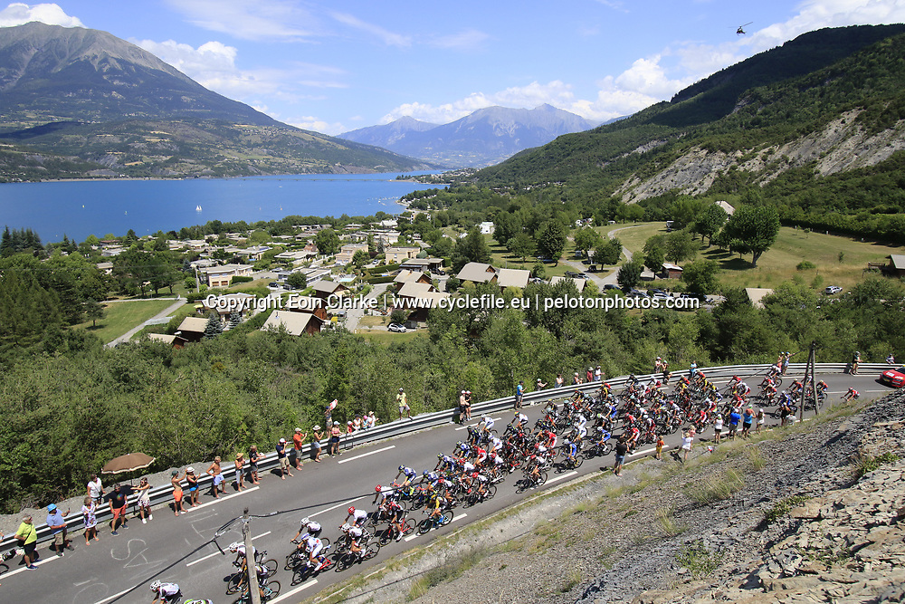 The peloton start to climb Cote de Demoiselles Coiffees at Lac de Serre-Poncon during Stage 18 of the 104th edition of the Tour de France 2017, running 179.5km from Briancon to the summit of Col d'Izoard, France. 20th July 2017.<br /> Picture: Eoin Clarke | Cyclefile<br /> <br /> All photos usage must carry mandatory copyright credit (&copy; Cyclefile | Eoin Clarke)