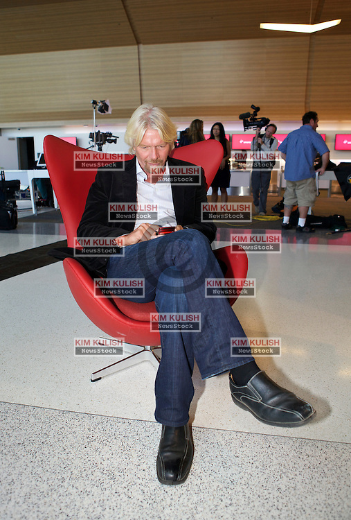 Virgin Group Founder Sir Richard Branson checks his smartphone for messages, following opening ceremonies for the new Terminal 2 at San Francisco International Airport.  The 640,000- square-foot Terminal is expected to be the first LEED Gold-certified terminal in the U.S.