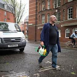 May0070113.DT features.Pic Shows Milkman Kevin Read on his round in the Whitechapel/Shoreditvh area