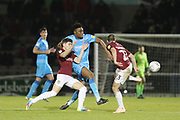 Scott Pollock , Rohan Ince  and Michael Harriman  during the EFL Sky Bet League 2 match between Northampton Town and Cheltenham Town at the PTS Academy Stadium, Northampton, England on 29 December 2019.