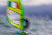 epa05478621 A slow shutter speed image of Flavia Tartaglini of Italy sailing during the women's RS:X class race of the Rio 2016 Olympic Games Sailing events in Rio de Janeiro, Brazil, 12 August 2016.  EPA/NIC BOTHMA