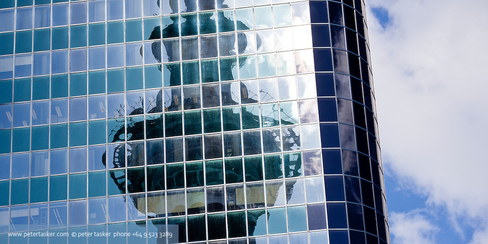 Auckland Skycity Sky Tower reflected in Phillips Fox Tower windows.