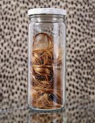 A glass jar with hair.