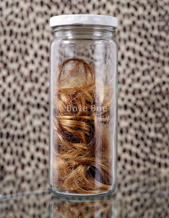 A glass jar with hair.