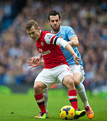 14.12.2013, Etihad Stadium, Manchester, ENG, Premier League, Manchester City vs FC Arsenal, 16. Runde, im Bild Manchester City's Alvaro Negredo, action against Arsenal's Jack Wilshere // during the English Premier League 16th round match between Manchester City and Arsenal FC at the Etihad Stadium in Manchester, Great Britain on 2013/12/14. EXPA Pictures © 2013, PhotoCredit: EXPA/ Propagandaphoto/ David Rawcliffe<br /> <br /> *****ATTENTION - OUT of ENG, GBR*****