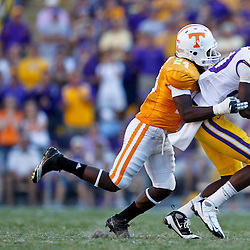Oct 2, 2010; Baton Rouge, LA, USA; LSU Tigers wide receiver Terrence Toliver (80) catches a pass over Tennessee Volunteers cornerback Eric Gordon (24) to convert for a first down during the fourth quarter at Tiger Stadium. LSU defeated Tennessee 16-14.  Mandatory Credit: Derick E. Hingle