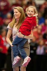 March 19, 2011; Stanford, CA, USA; St. John's Red Storm head coach Kim Barnes Arico celebrates with her daughter after the game against the Texas Tech Lady Raiders during the first round of the 2011 NCAA women's basketball tournament at Maples Pavilion. St. John's defeated Texas Tech 55-50.