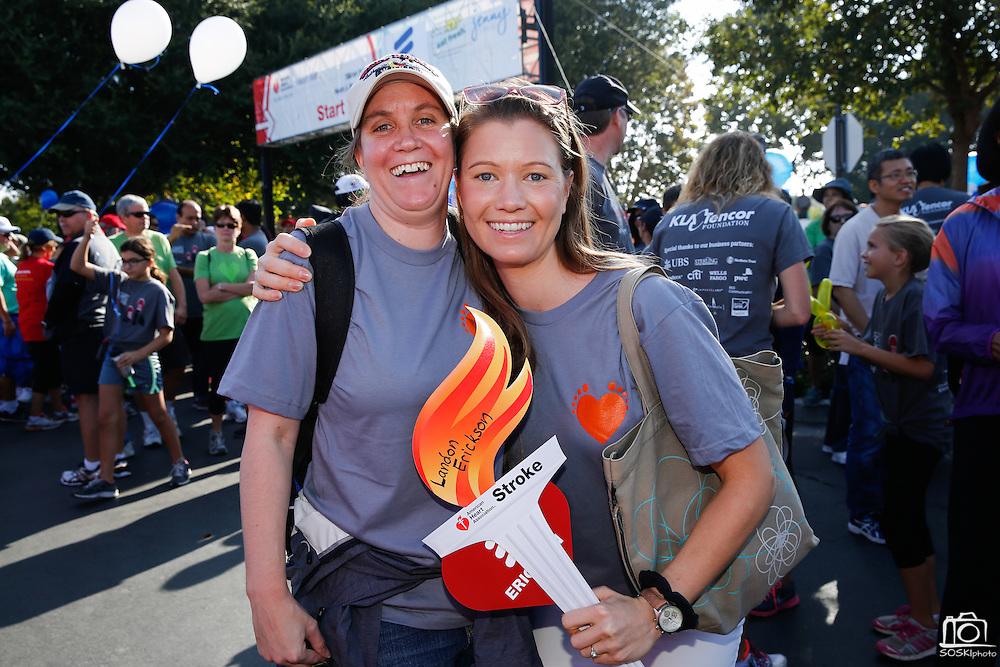 Kristin Erickson, left, of San Jose, and her sister Karin Chyla-Erickson of Ventura County pose for a portrait during the 2014 Silicon Valley Heart & Stroke Walk at KLA-Tencor in Milpitas, California, on October 11, 2014. (Stan Olszewski/SOSKIphoto)