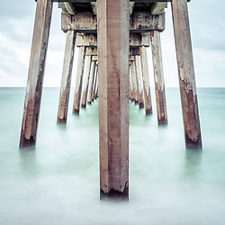 Pensacola Beach Gulf Pier pilings and Gulf of Mexico photo. Pensacola Beach is on Santa Rosa Island in the Emerald Coast of the Southeastern United States of America. Copyright ⓒ 2018 Paul Velgos with All Rights Reserved.