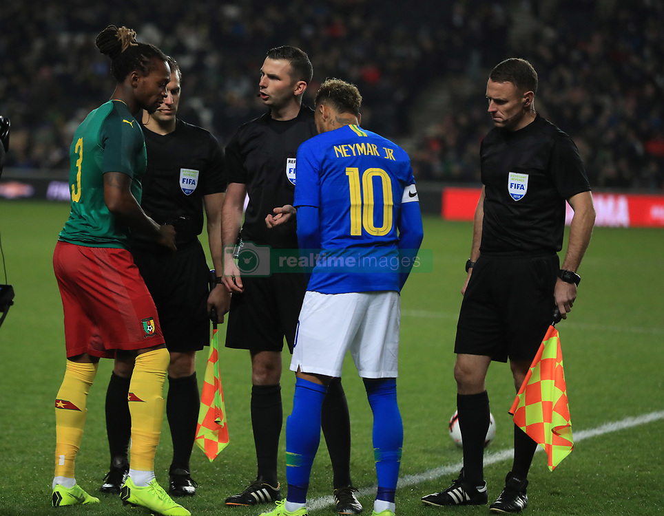 Brazil's Neymar shakes hands with Cameroon captain Gaetan Bong before the international friendly match at Stadium MK, Milton Keynes.