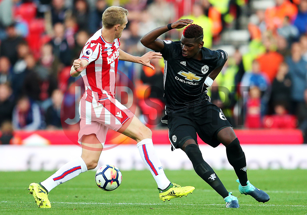 Paul Pogba of Manchester United takes on Darren Fletcher of Stoke City - Mandatory by-line: Matt McNulty/JMP - 09/09/2017 - FOOTBALL - Bet365 Stadium - Stoke-on-Trent, England - Stoke City v Manchester United - Premier League
