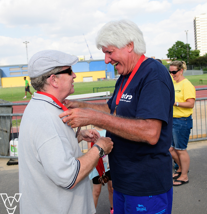 Metro Blind Sport's 2017 Athletics Open held at Mile End Stadium.  Medal presentations.  Mike Brace, left, and Roy Smith<br /> <br /> Picture: Chris Vaughan Photography for Metro Blind Sport<br /> Date: June 17, 2017