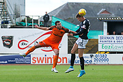 Dundee defender Jack Hendry (#22) wins a header ahead of Dundee United defender Lewis Toshney (#6) during the Betfred Scottish Cup group stage match between Dundee and Dundee United at Dens Park, Dundee, Scotland on 29 July 2017. Photo by Craig Doyle.