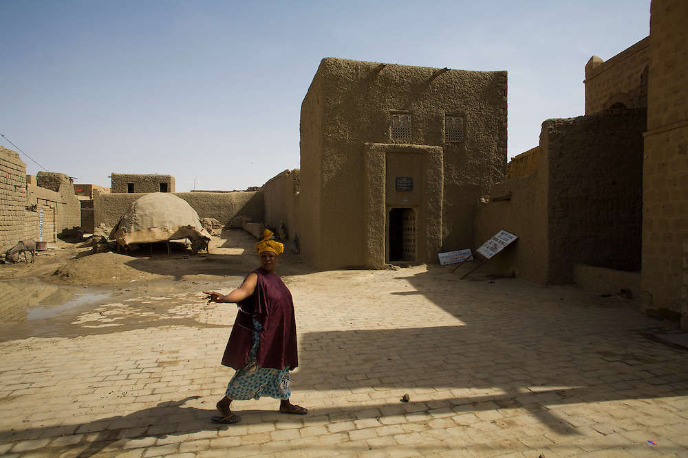 Woman passes in front of Alexander Gordon Laing's house  in Timbuktu, Mali. Gordon Laing was a british explorer and the first european to reach Timbuktu from the north7south route through Sahara desert.