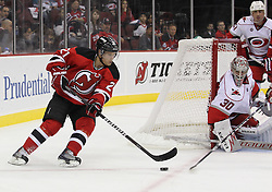 Oct 10; Newark, NJ, USA; New Jersey Devils left wing Mattias Tedenby (21) skates with the puck during the second period at the Prudential Center.