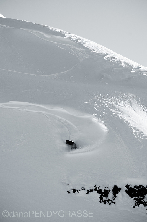 A snowboard slashed a texured powder face in British Columbia.